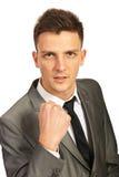 Злющий бизнесмен показывая кулачок Стоковые Фото
