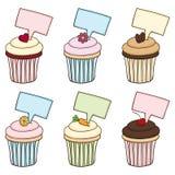 乱画杯形蛋糕设置与符号 免版税库存图片