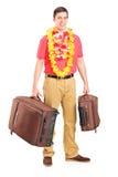 新男为启运做准备,摆在与他的皮箱 免版税库存图片