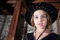 Молодая ведьма в шлеме Стоковая Фотография
