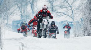 冬天摩托车越野赛 免版税图库摄影
