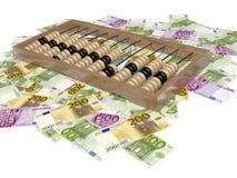 算盘和货币 免版税库存照片