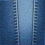 蓝色牛仔裤牛仔布与针的织品纹理 库存照片