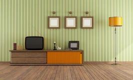 减速火箭的电视在客厅 免版税库存照片