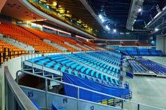 有扶手椅子行的空的体育馆  免版税库存图片