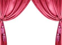 有在白色查出的缨子的红色丝绸窗帘 免版税库存照片