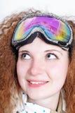 戴眼镜的俏丽的挡雪板纵向  免版税库存图片