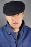 盖帽的边缘人 免版税图库摄影