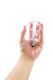 递拿着电灯泡查出与裁减路线 免版税库存照片