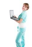 有膝上型计算机的成功的女商人 库存照片