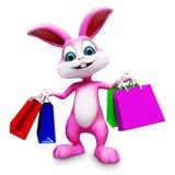 与购物袋的兔宝宝 免版税库存图片
