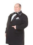 蝶形领结指向的典雅的肥胖人 免版税图库摄影