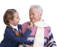 有她的孙女的祖母 图库摄影
