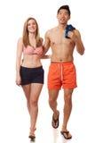 在游泳衣的新夫妇 免版税库存照片
