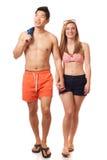 在游泳衣的新夫妇 图库摄影