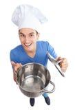 拿着空的罐的主厨 免版税库存图片