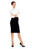 有被交叉的双臂的美丽的女实业家 免版税图库摄影
