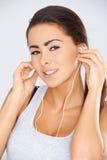 有耳机的少妇 免版税图库摄影
