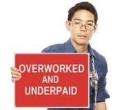 劳累过度和少付的工资 库存照片