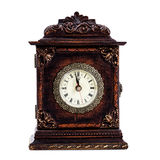 击中午夜或中午的古色古香的时钟 免版税库存照片