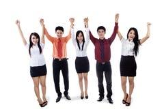 在胜利的企业小组被举的手 免版税库存照片