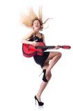 女性吉他演奏员 免版税图库摄影