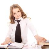 作为确信的女商人打扮的小女孩 免版税库存照片