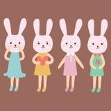 在的兔子动画片不同的衣裳 免版税库存照片