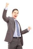 打手势幸福的激动的年轻专业人 免版税库存图片