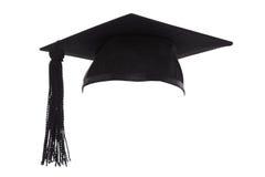 灰浆板在白色隔绝的毕业盖帽 免版税库存图片