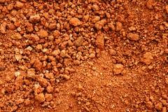 红色地球或土壤背景 免版税库存照片