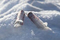 血淋淋的使用的注射器 免版税图库摄影