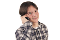 十几岁的男孩谈话在移动电话 库存照片
