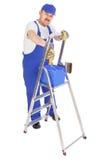 有梯子的房屋油漆工 免版税图库摄影