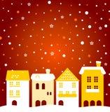 Ζωηρόχρωμη πόλη χειμερινών Χριστουγέννων με το χιόνι πίσω Στοκ Εικόνα