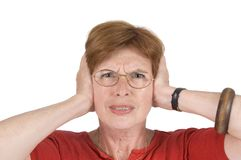 женщина старшия ушей заволакивания Стоковое фото RF