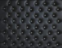 黑皮革金刚石散布的豪华背景 免版税库存照片