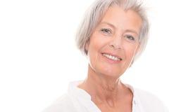 Усмехаясь старшая женщина Стоковые Изображения
