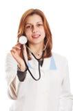 有听诊器的可爱的女性医生 免版税库存图片