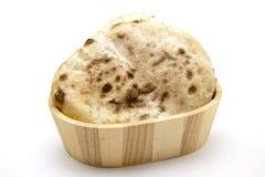 圆的平的面团结块面包 免版税库存图片
