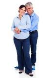 中部年迈的夫妇拥抱 库存图片