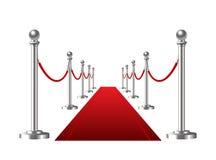 在白色背景隔绝的红色事件地毯。 免版税库存图片