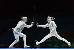 妇女在世界冠军竞争在操刀的 免版税库存照片