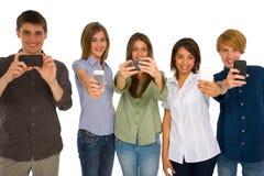 有智能手机的少年 免版税图库摄影