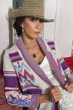 美丽的妇女佩带的设计师夹克 免版税图库摄影