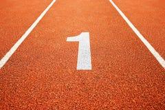 Αριθμός ένας στο τρέξιμο της διαδρομής Στοκ Φωτογραφία