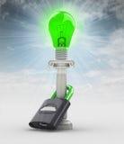保护在天空的绿色能量电灯泡概念 免版税库存照片