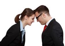 企业在头的夫妇头 图库摄影
