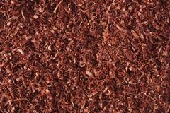 罚款被磨碎的巧克力背景 免版税库存图片