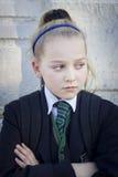 恼怒的女小学生 免版税库存照片